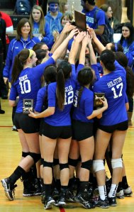 The Sherwood High School girls volleyball team celebrates its third consecutive state championship.